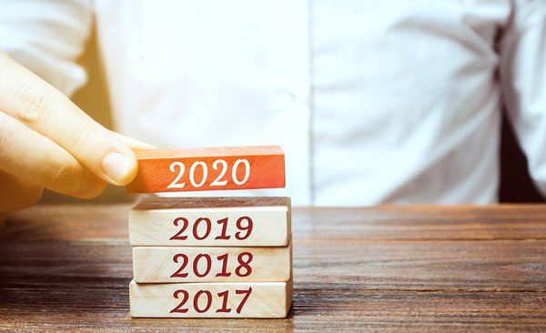 Wooden blocks labeled with 2017, 2018, 2019 and 2020.